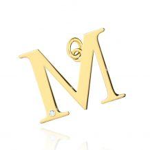 Złota literka M z brylantem