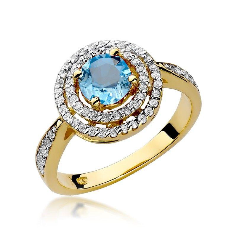 Okrągły pierścionek z topazem i brylantami